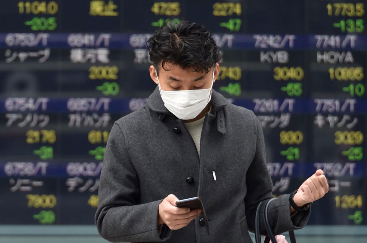 خبرنگاران ریزش شاخص سهام در آسیا با شیوع گسترده کرونا